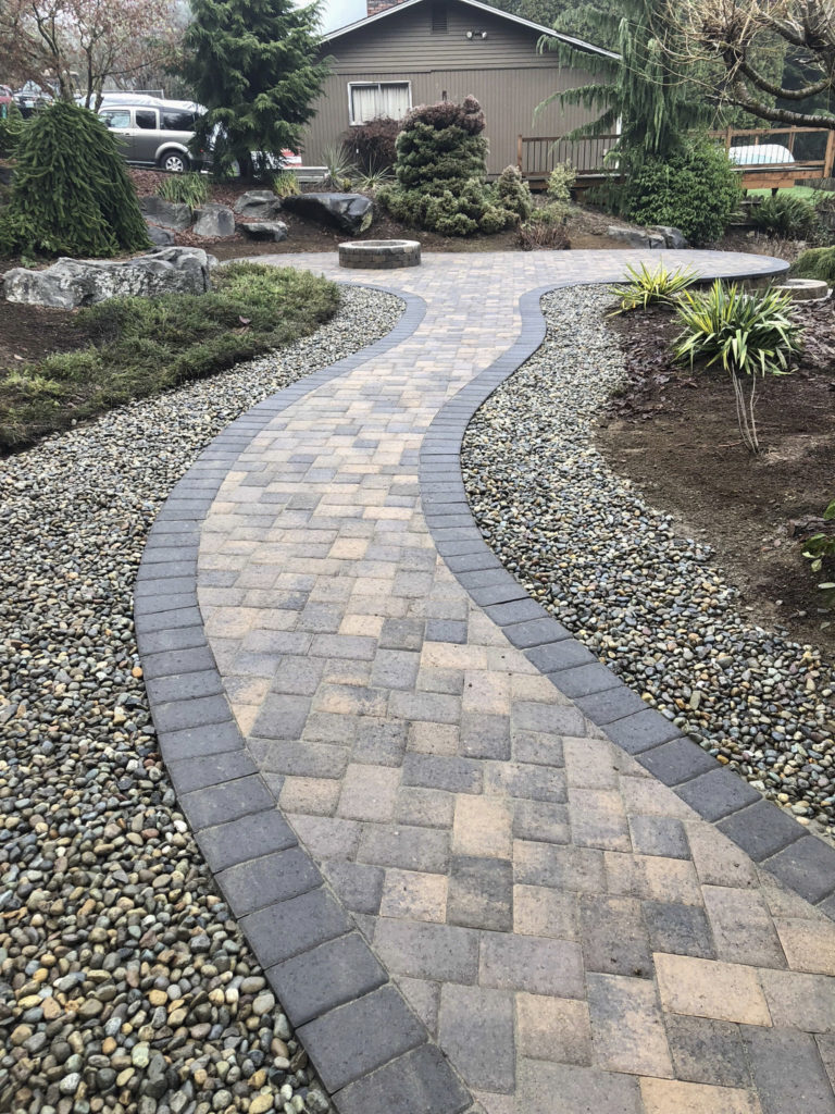walkway with curves and firepit
