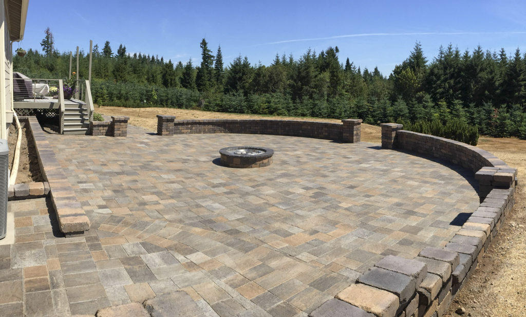 back yard paver patio with fireplace