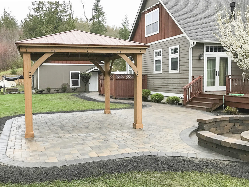 paver patio seating benches and pergola