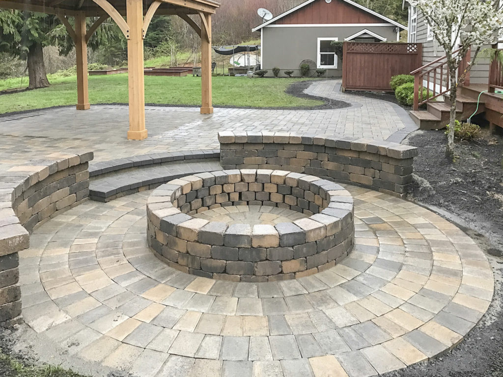 sunken patio with fire pit and seating benches