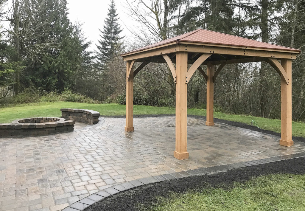 paver patio with pergola and sunken fire pit