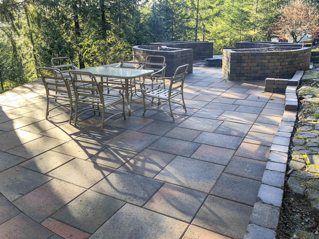 la lastra paver patio with chateau wall planters and retaining walls