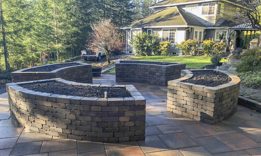 chateau wall raised flower beds on paver patio