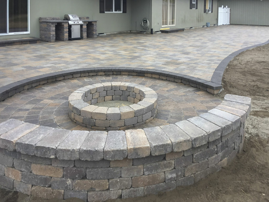 patio with sunken area and seating benches