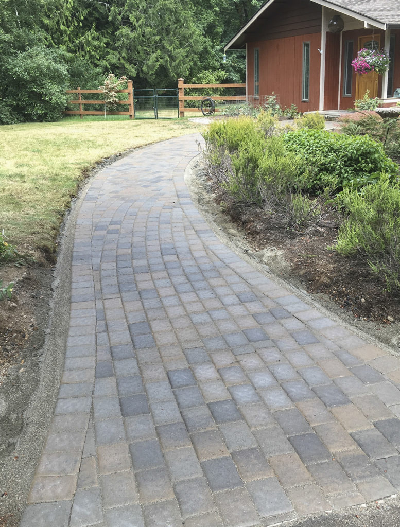 Walkway through yard and flower beds