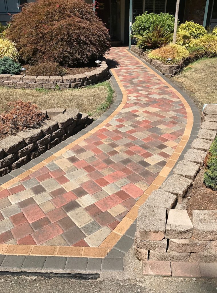 Walkway with double border through retaining wall beds