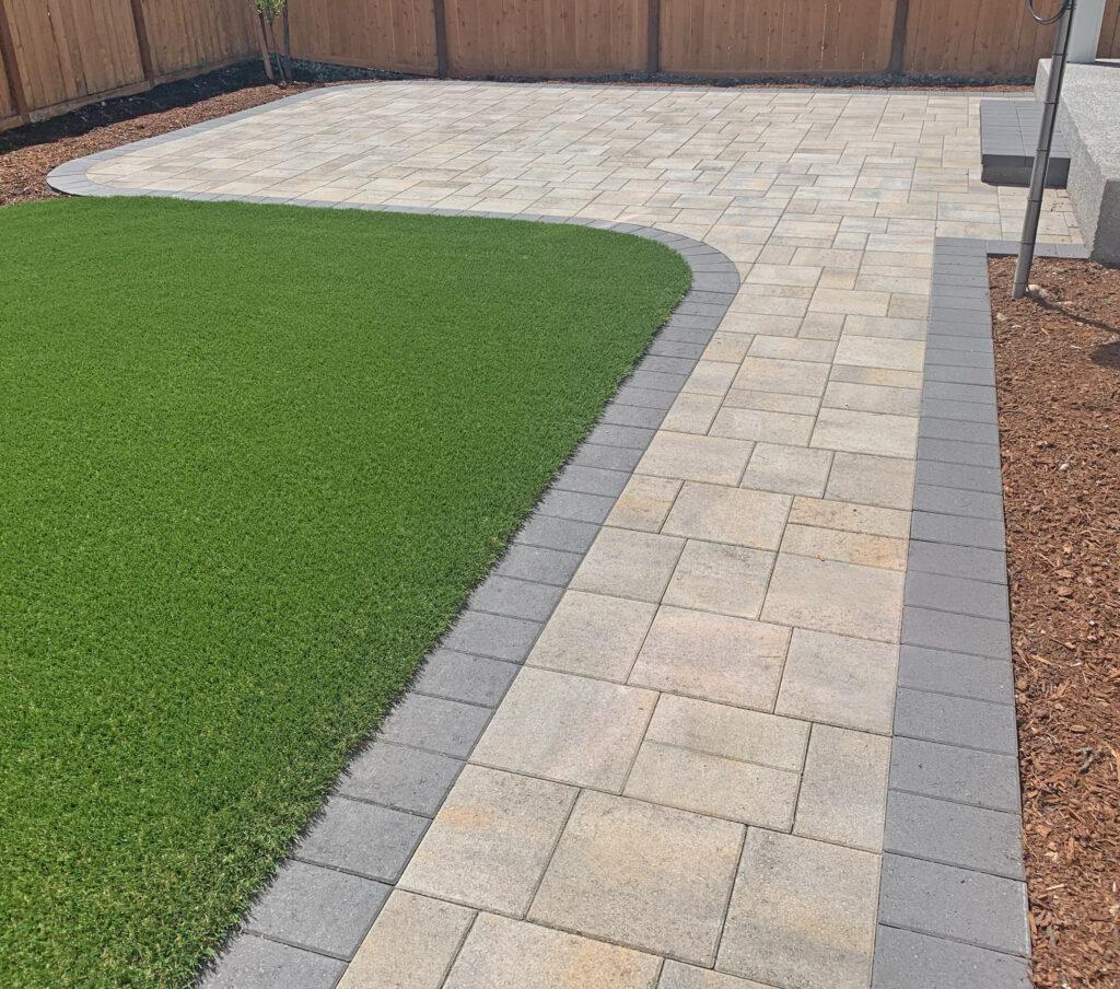 turf and paver walkway and patio