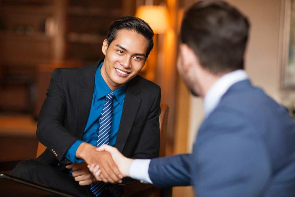 two persons shaking hand in a professional services introduction meeting