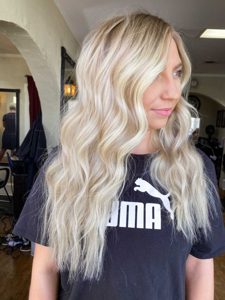 Blonde hair with lowlights and highlights that look buttery, champagne, and creamy while keeping that bright blonde