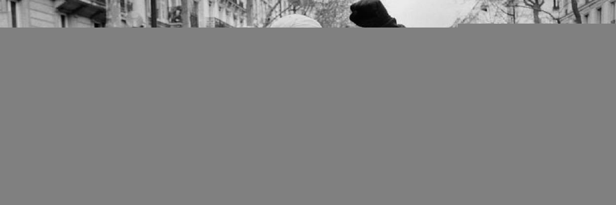 FRANCE. 2006. Paris. Muslims rally vs. publication of cartoons of their prophet Muhammad the in the western press. Young men, hiding their faces behind a mask, lead a section of the march. By Abbas ( Agência Magnum).