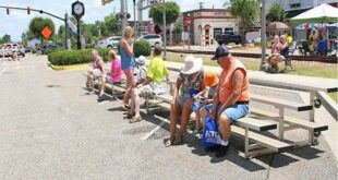 A small crowd gathered at the stage to listen to performers sing and to music sponsored by Banana Jack Murphey.