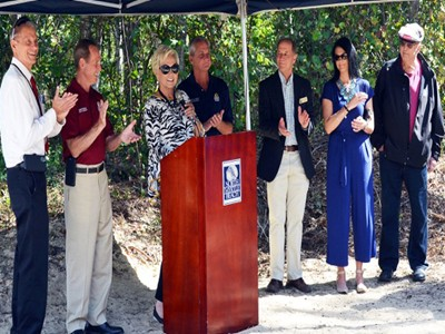 Mayor Hatley and city officials gather to thank those responsible for Ingram Dunes Natural Area