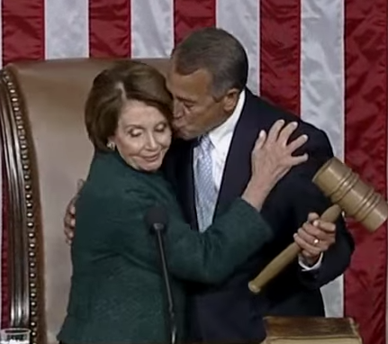 House Speaker John Boehner kisses House Minority Leader Nancy Pelosi