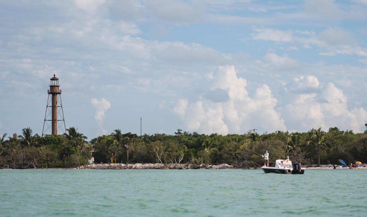CAPTAIN WHITNEY'S BOAT INFRONT OF SANIBEL LIGHTHOUSE