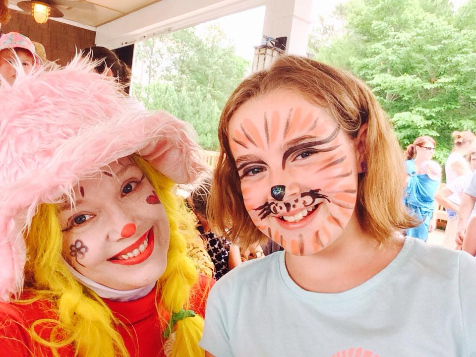 Corky Magic painting faces at a Charlotte NC event