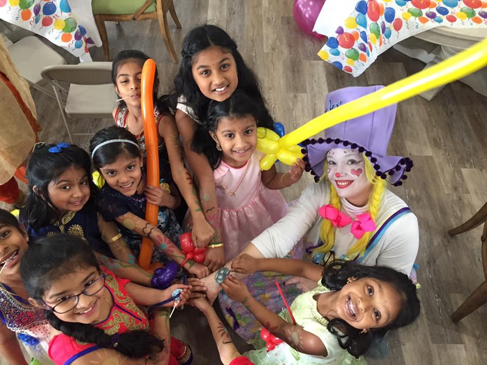 Corky Clown creating balloon art for a child's birthday