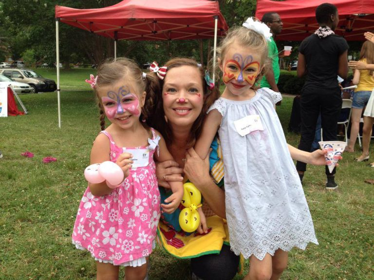 Children loving their butterfly face paint done by Corky the Clown Light version