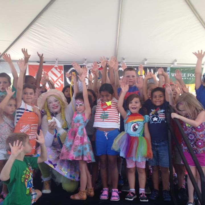 Corky Magic with children at home depot event