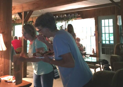 Friday, July 21 at the welcome dinner at Merrianne and Gib McGill's house - Charlotte Weaver-Gelzer and Sandra Jamison