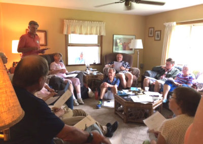 General Meeting of SASAF in the Stultz Farm Living Room.  Third person from the left - in pink on couch is Charlotte Weaver-Gelzer, standing to her left is Steve Jamison (presiding), to his right - Sandy Jamison, in the window is Kirk Lindly, on the floor is Bill Pollock and Ed Pollock is sitting in the big armchair, front right is Kathy Ammon and on the couch closest to and to the right of the Pollocks is Kenny Cooke, then Lavine Pattee.  Back of head to the left is Ron Pollock