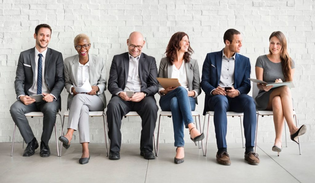 Team of Recruiters sitting in a row