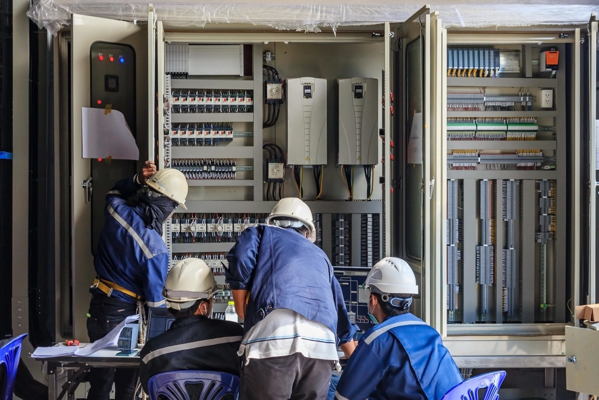 Energy Efficiency Experts inspecting an industrial electrical panel