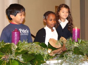 Our students prepare for Christmas by lighting the Advent candles.