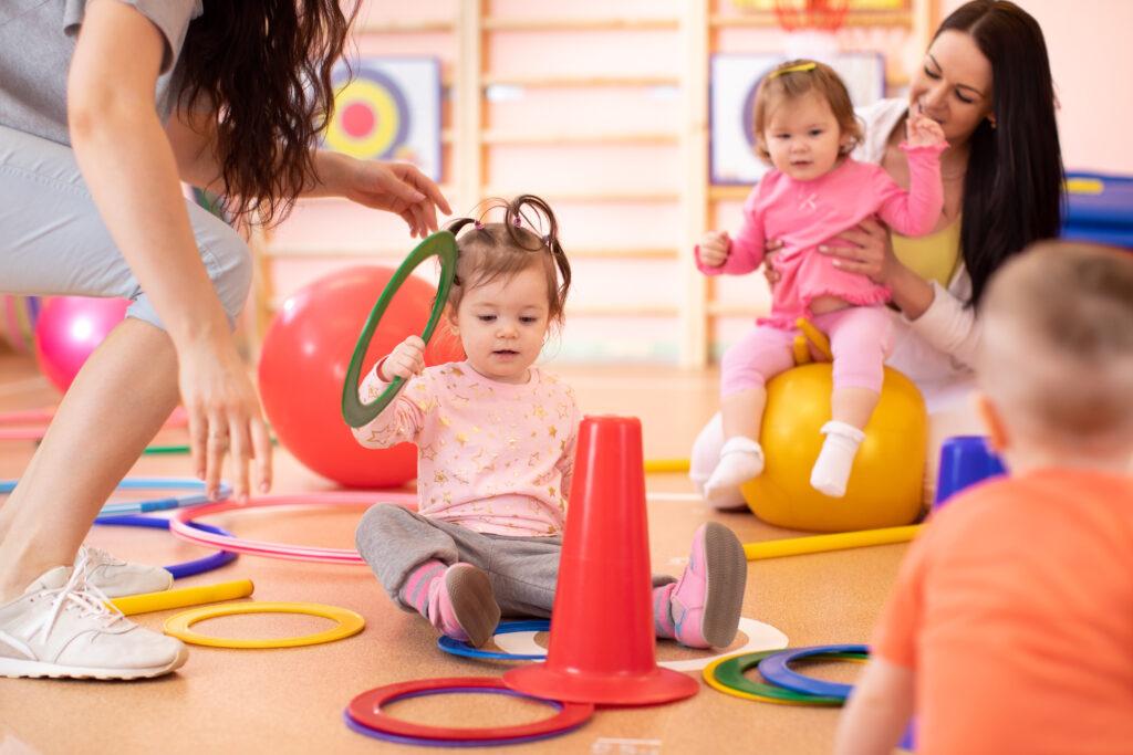 Nursery babies group doing sport in fitness club