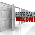 20622183 - the words referrals welcome coming out an open door to encourage customers to refer friends and family to your business