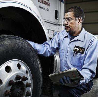 RIG360 Service Man Checking Tire Tread