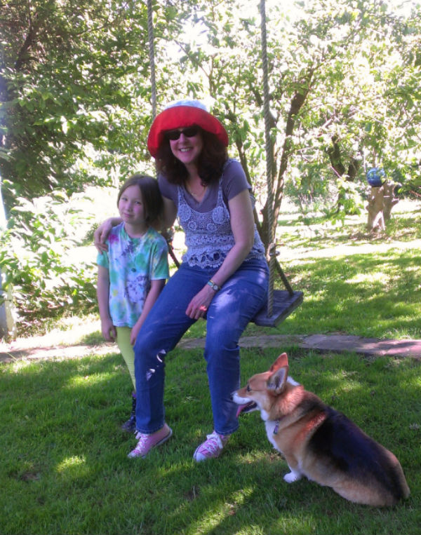 Nicole Rubel with Deanna's daughter, Faith, who during our visit encountered all sorts of garden delights, among them, a rather laid-back and well-fed, large gray snake.