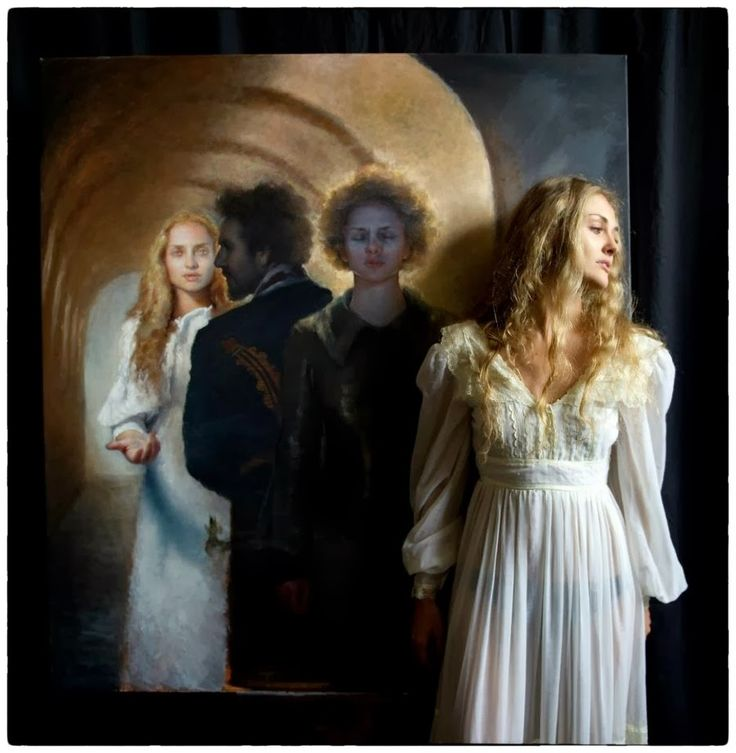 Maria Kreyn standing with her painting Tunnel