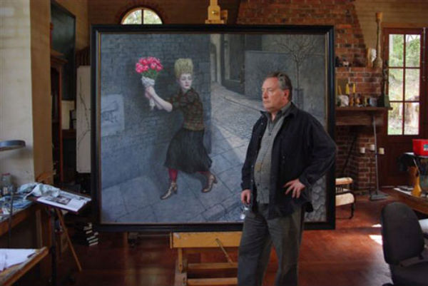 Australian surrealist painter Mike Worrall in front of his work, The Bouquet.