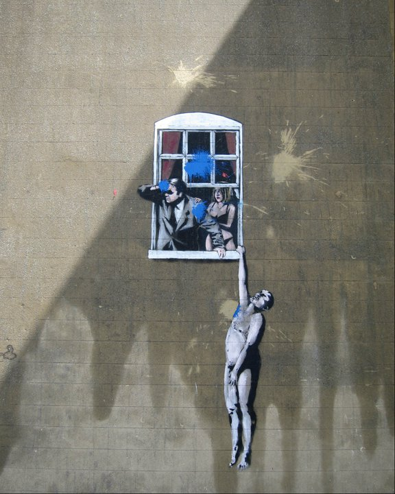 Banksy's Love Triangle. The city's reclaiming the space with blue paint bombs