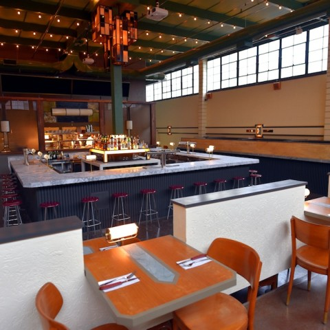 Syndicated bar with tables in foreground