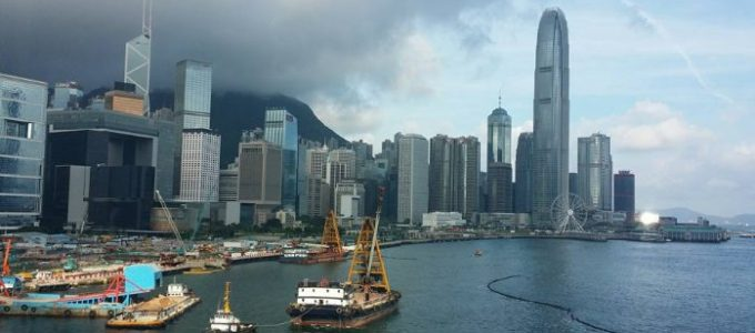 Hong Kong city skyline, Grey clouds, boats in the foreground