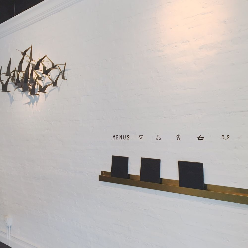 Owen + Alchemy Chicago menu wall