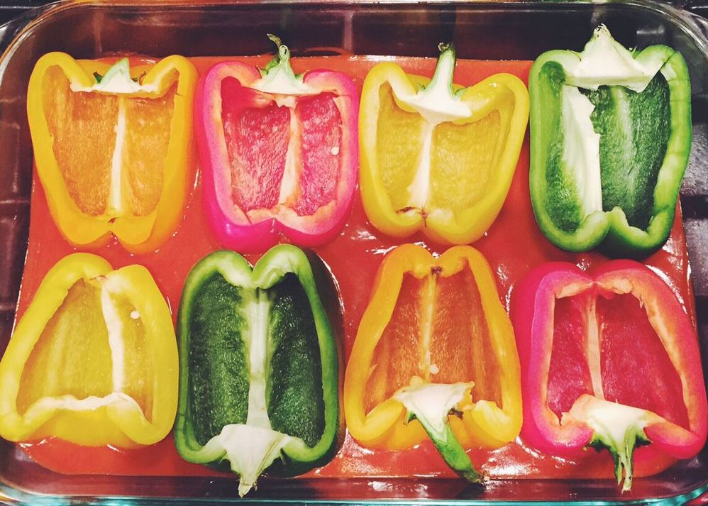 peppers halved on enchilada sauce