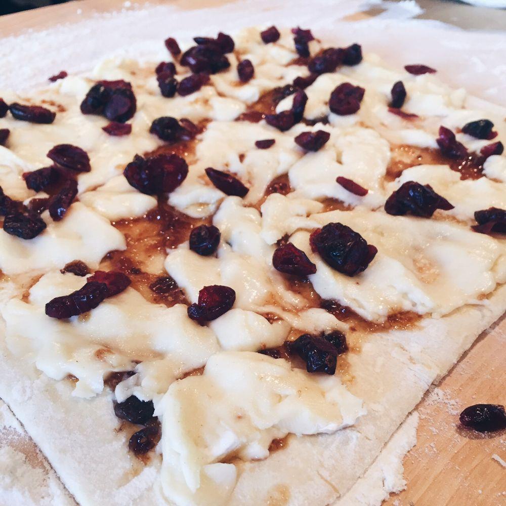 spread softened brie + sprinkle dried cranberries