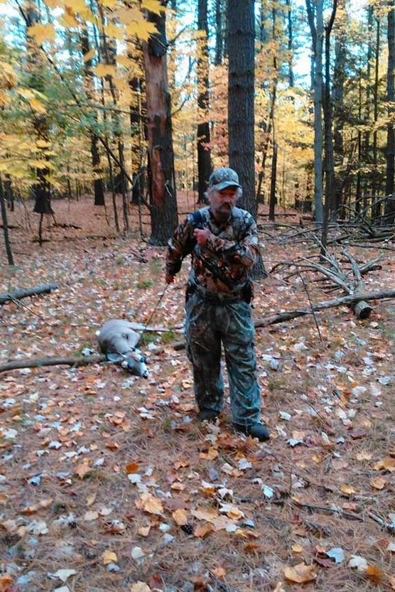 "Ron ""Cubby Buttons"" Nadler of Corinth drags out a doe he shot on Oct. 17 near Lake George during the early muzzleloading season."