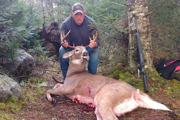 2017: Burce Mitchell's dad with a 180-pound, 11-pointer shot in Blue Mt. Lake, Nov. 3.