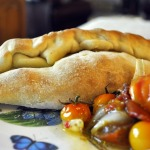 Smitten Kitchen:  Eggplant Calzone with Three Cheeses and Roasted Tomato and Onion Sauce