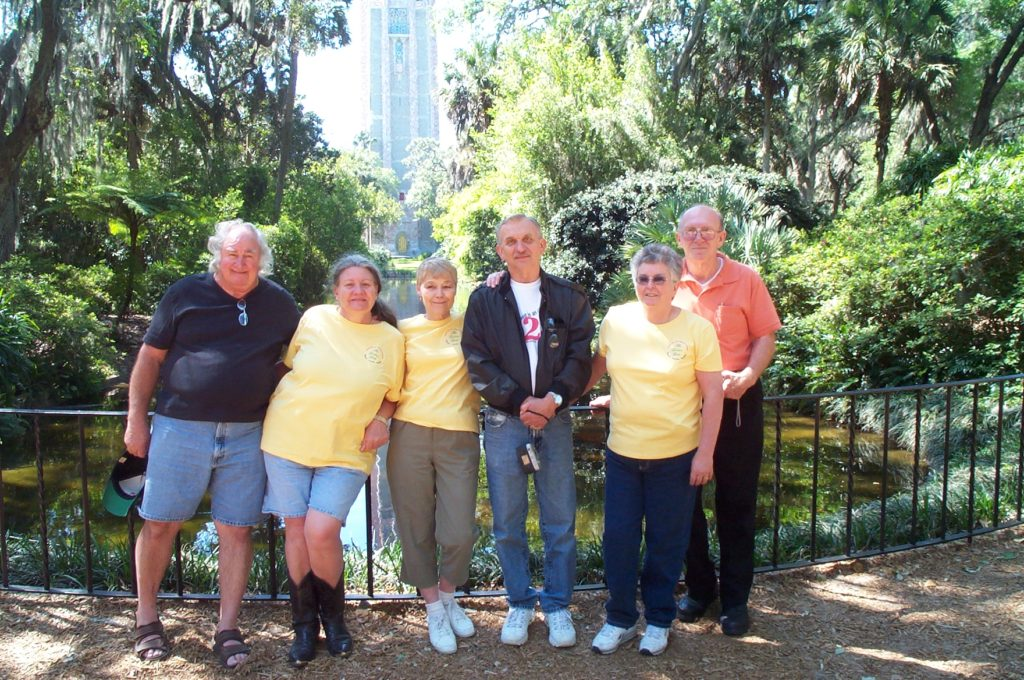 Six friends with Bok Tower in the background.