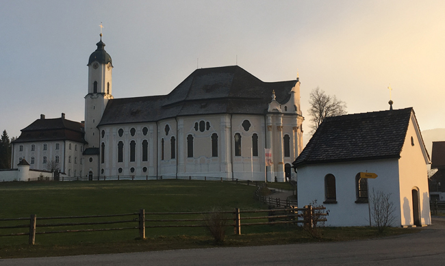 Wieskirche - Pilgrimage Church. The small building in front is on par with the original chapel for size. Once you have a 'miracle' though, you need to upsize for all the pilgrims...hence the great pile in the background.
