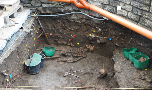 They're still digging up the past right outside the door of the Sedlec Ossuary.