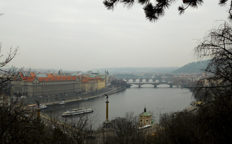 Views over Old Town and the Vltava River, crossed by her many bridges, including Charles Bridge with its statues, from Letná Park.