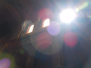 Sunshine struggling to brighten the ancient, brooding interior of Notre-Dame de la Daurade.