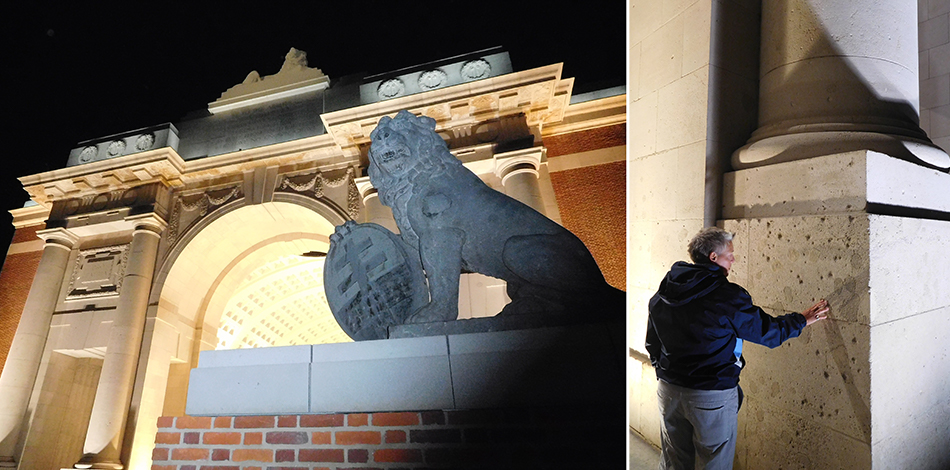 Menin Gate shines brightly at night. Shellfire has pockmarked the plinths.