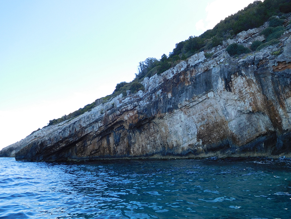 The interesting geology makes the cliffs appear to spear into the water near the Blue Cave on northern Zante