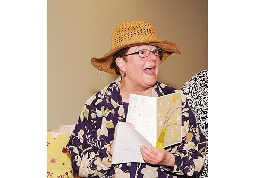 Lucille reads a card at her retirement party